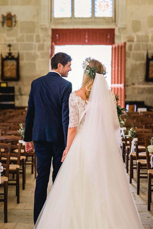 Photographe de mariage sortie de l'église